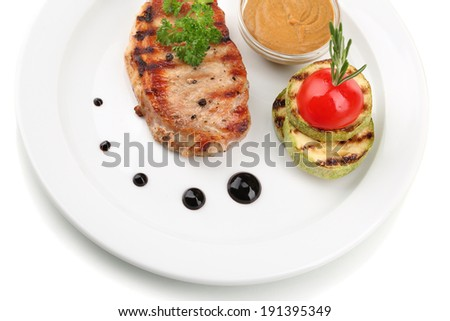 Grilled steak and grilled vegetables on plate, isolated on white