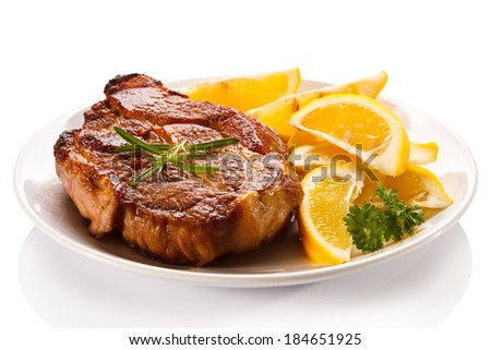 Grilled steak and lemon - stock photo
