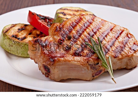 Grilled steak and vegetables on a  plate - stock photo