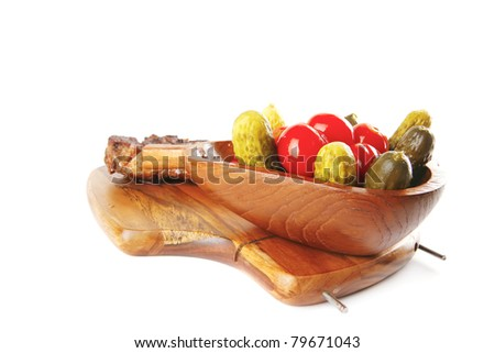 grilled steak and vegetables on wooden plate