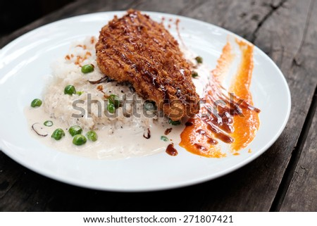 Grilled steak fish and olive white sauce, Japanese food on old wood - stock photo
