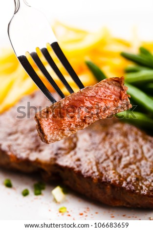 Grilled steak, French fries and green beans - stock photo