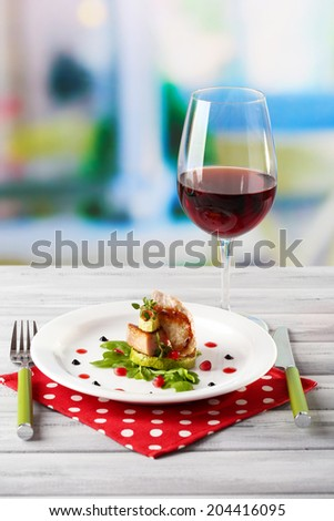 Grilled steak, grilled vegetables and arugula on table, on bright background