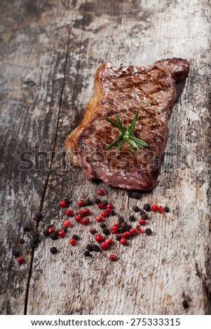 grilled steak on a wooden plank  - stock photo