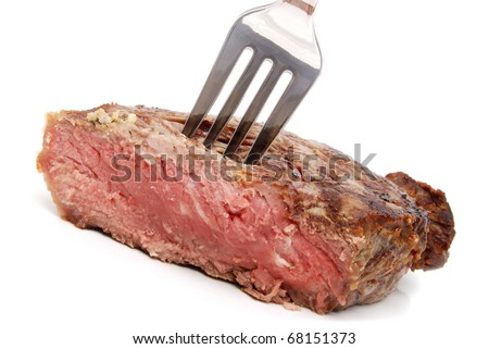 grilled steak on fork - stock photo