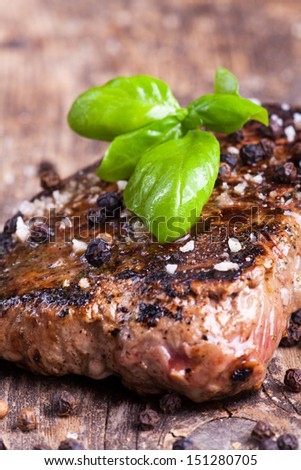 grilled steak with basil, peppercorns and salt  - stock photo