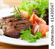Grilled steak with fresh vegetables and herbs - stock photo