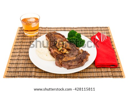 Grilled steak with mashed potatoes, fried mushrooms, and  vegetables - stock photo