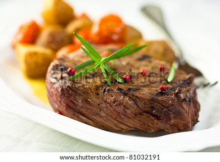 Grilled steak with roasted vegetables - stock photo