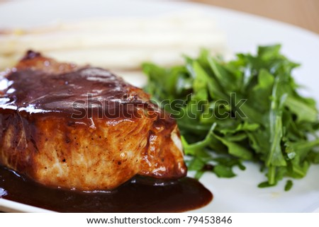 Grilled steak with rucola, asparaghus and sauce - stock photo