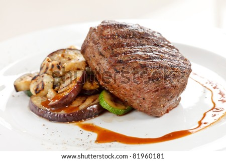 Grilled steak with vegetables - stock photo
