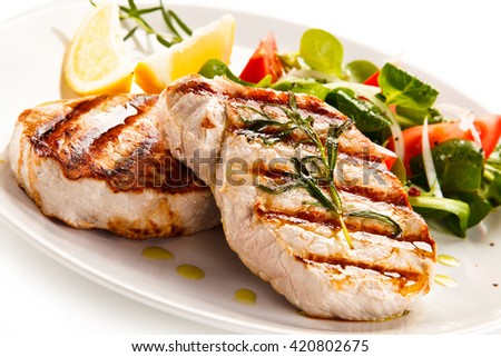 Grilled steaks and vegetables - stock photo