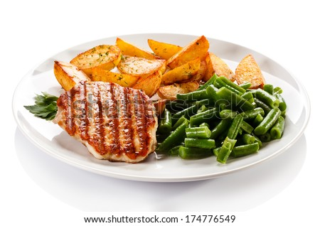 Grilled steaks, baked potatoes and vegetables  - stock photo
