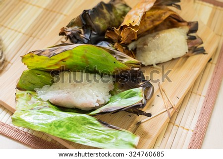 Grilled Sticky Rice with taro and banana, Thai food - stock photo