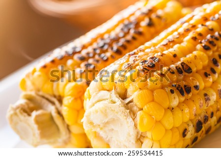 Grilled sweet yellow corn with melted butter