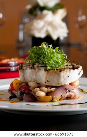 Grilled swordfish over fresh vegetables - stock photo
