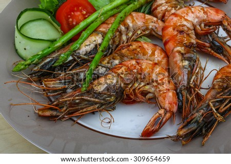 Grilled tiger prawn with asparagus and salad leaves - stock photo