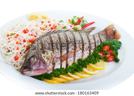 Grilled tilapia served with pasta and vegetables. - stock photo