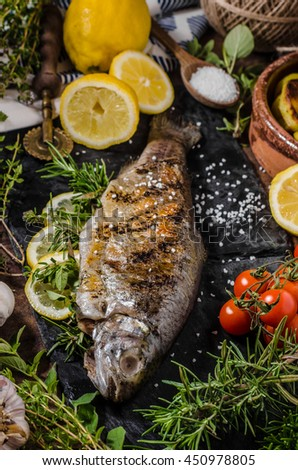 Grilled trout stuffed with herbs and lemons, delicious and very fast cook fish - stock photo