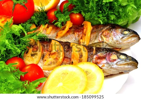 grilled trout with fresh herbs, vegetables and lemon - stock photo