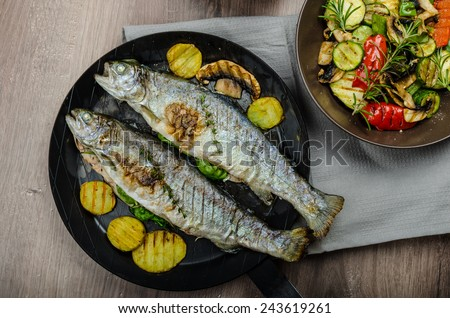 Grilled Trout with Mediterranean vegetables, fresh fish with healthy vegetable, best bio healthy meal - stock photo