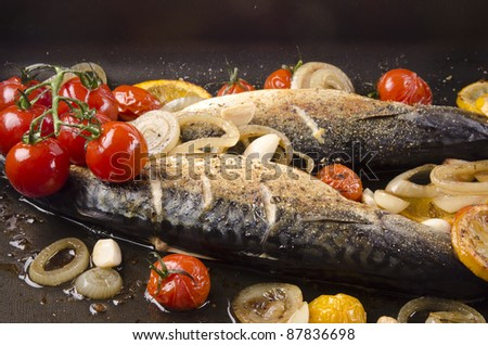 grilled trout with tomato, garlic and lemon slices - stock photo