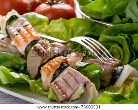 grilled tuna and salmon skewers - stock photo