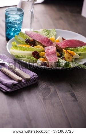 Grilled tuna salad nicoise with fresh tuna - stock photo