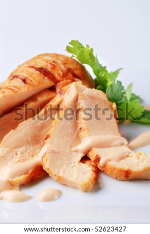 Grilled turkey breast on a square plate - stock photo