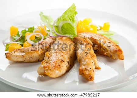 Grilled turkey fillet and vegetable salad - stock photo