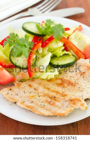 grilled turkey with vegetables on plate
