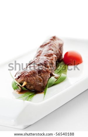 Grilled Veal Meat  Garnished with Cherry Tomato and Green Leaf - stock photo