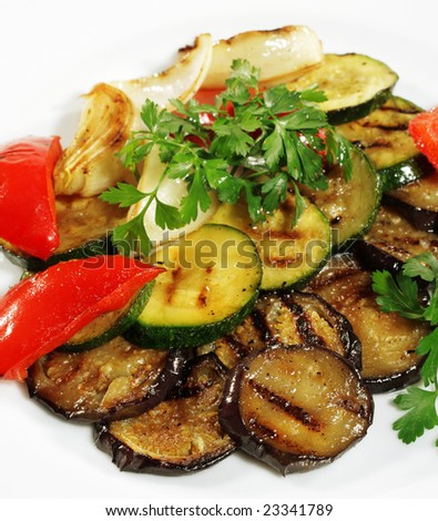 Grilled Vegetables Plate Served with Parsley and Fresh Red Pepper. Isolated on White Background - stock photo
