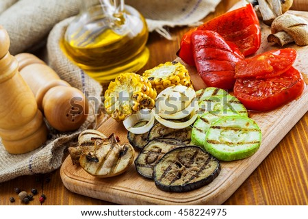 Grilled vegetables: tomato, corn, eggplant, mushroom, bell pepper, marrow and onion. Delicious healthy food on a table. Close-up shot.