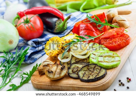 Grilled vegetables: tomato, corn, eggplant, mushroom, bell pepper, marrow and onion. Delicious healthy food and ingredients on a table.
