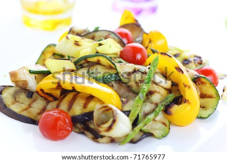 Grilled vegetables (zucchini, eggplant, onions, peppers, asparagus, tomato) - stock photo
