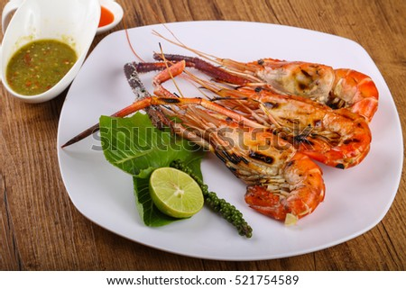 Grilled waterprawn with herbs, spices and sauce