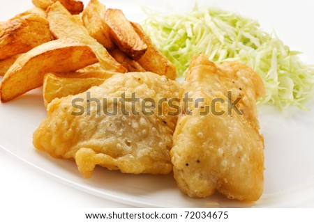 Grilled white fish and chips with salad