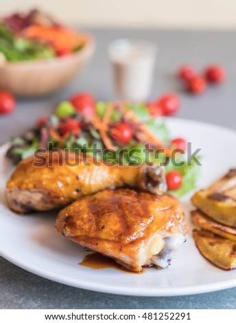 grilles chicken steak with teriyaki sauce on dining table