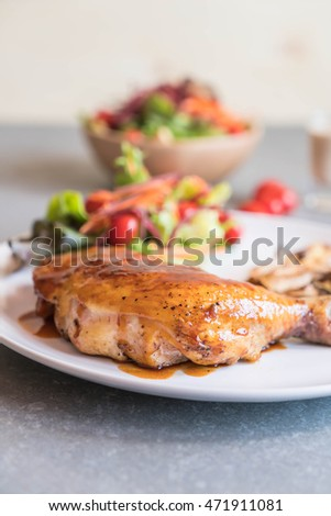 grilles chicken steak with teriyaki sauce on dinning table