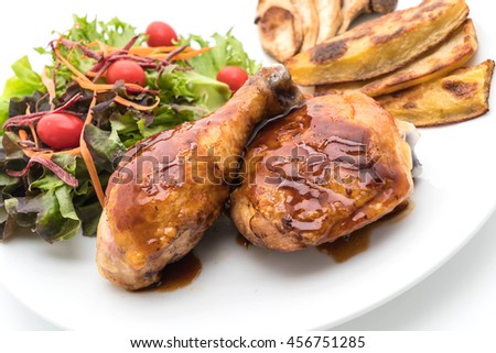 grilles chicken steak with teriyaki sauce on white background