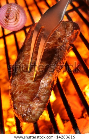 Grilling a steak - stock photo