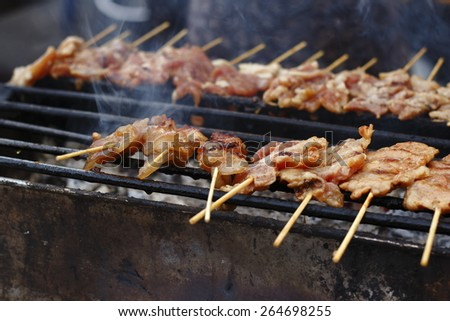 grilling pork in local market - stock photo