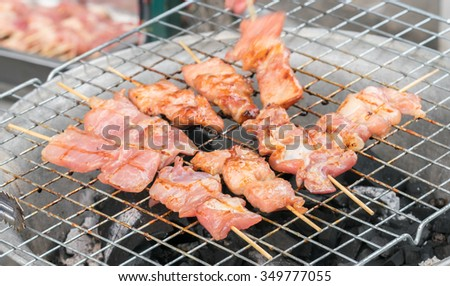 grilling pork with stick