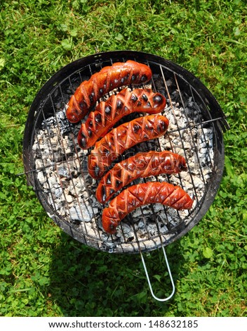 Grilling Sausages on barbecue grill - stock photo