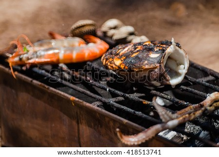 Grilling seafood on charcoal grill