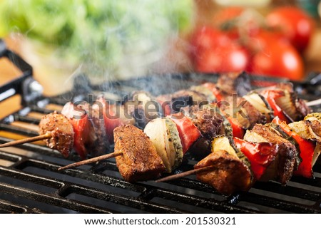 Grilling shashlik on barbecue grill.  - stock photo