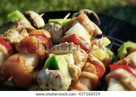 Grilling shashlik on barbecue grill (Selective focus)