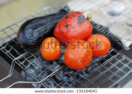 Grilling vegetables on pan - stock photo