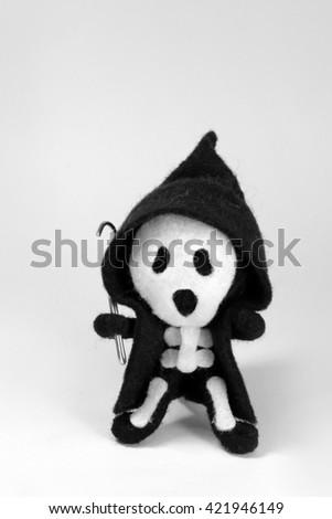Grim Reaper felt rag doll with clothing - stock photo